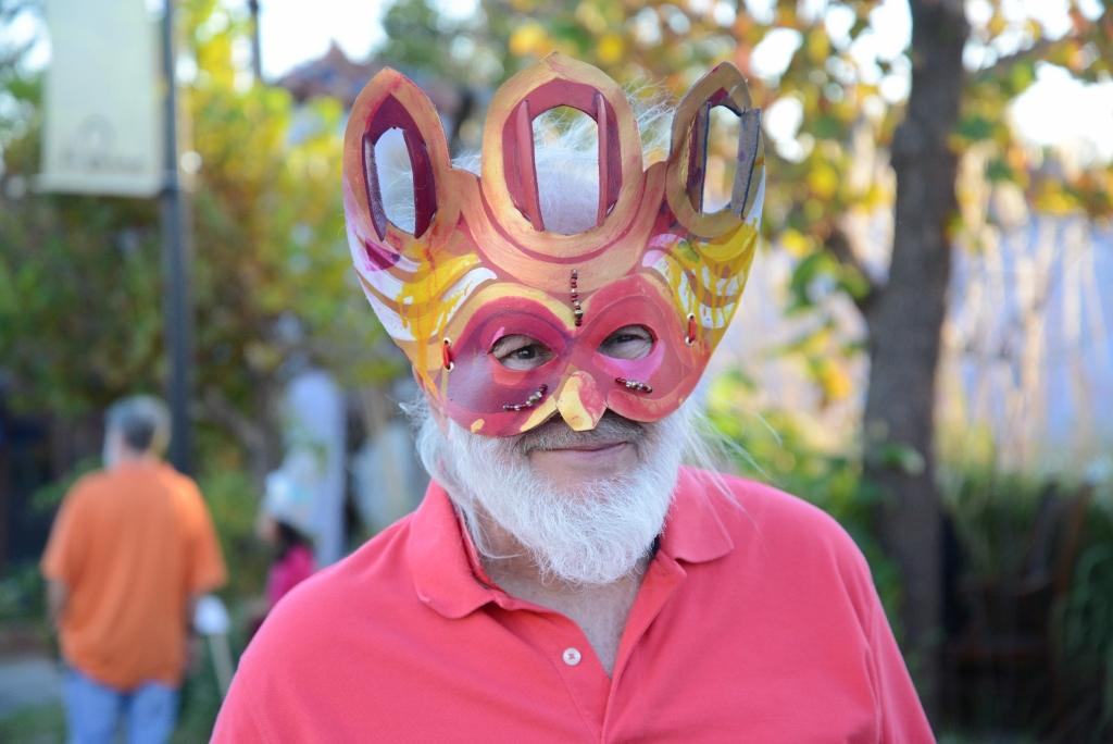 Man in fun mask magic lantern festival