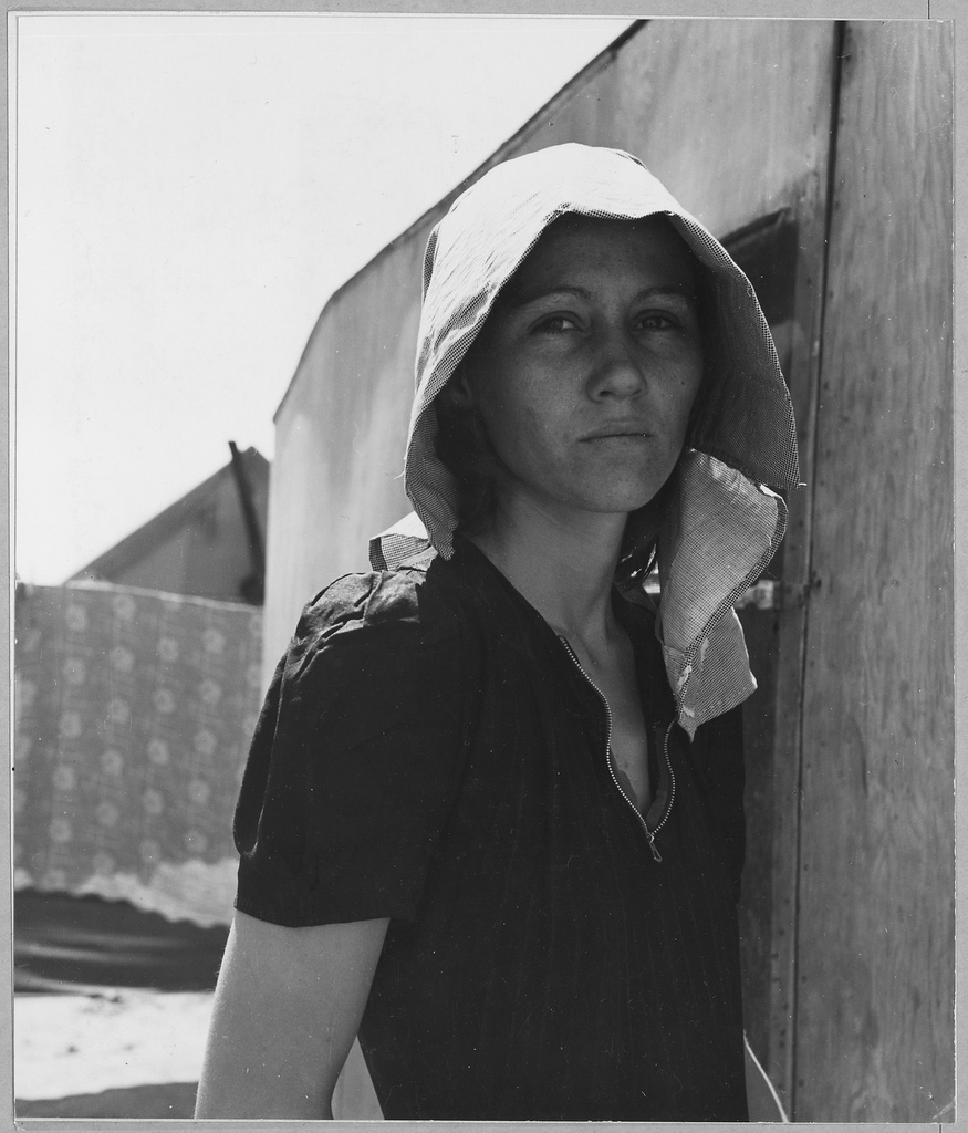Migrant working mother of two from Texas, 1940. She picked peas in Kern County, California. U.S. Archives