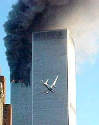 A jet airliner is lined up on one of the World Trade Center towers in New York Tuesday, Sept. 11, 2001. (AP Photo/Carmen Taylor via KHBS/KHOG-TV)