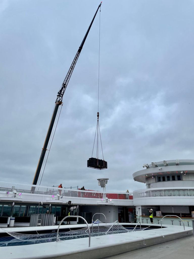 Craning a stage onto a cruise ship.