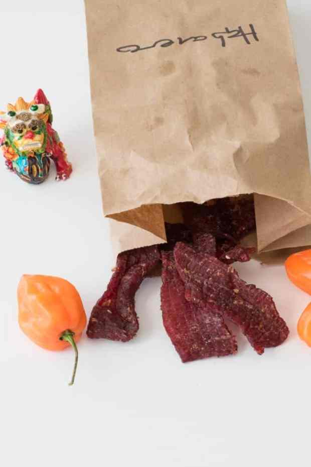 Beef Jerky in brown bag with habanero peppers