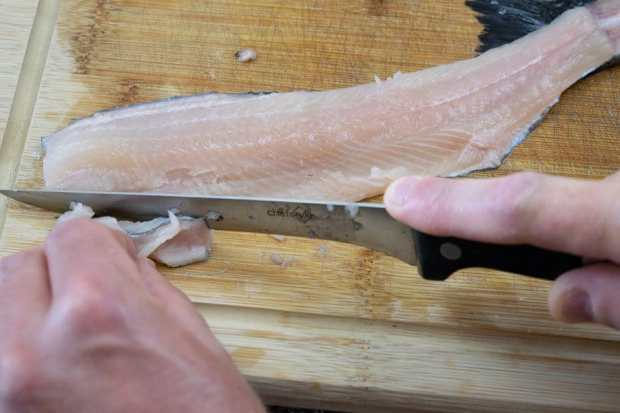 deboning trout on cutting board