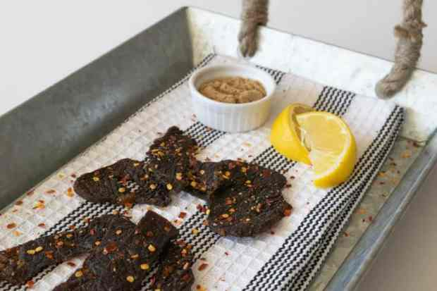 Simply Sweet Beef Jerky on tray with lemons and brown sugar