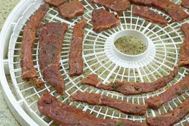 beef jerky on dehydrator tray
