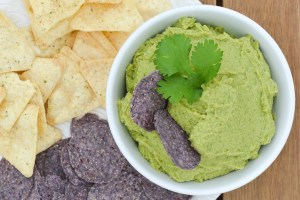"This Avocado Hummus-- or ""Guacamummus""-- is the perfect smooth combination of creamy avocado and chick peas. It's lightly spiced with guacamole flavors and the perfect healthy snack paired with veggies or tortilla chips!"