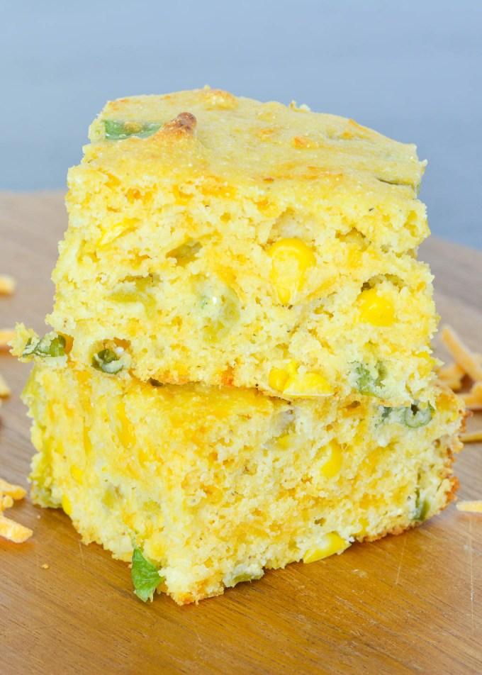 This Cheddar Jalapeno Cornbread is kicked up with jalapenos, green chilies, scallions and more! It's the perfect flavorful side dish to a warm bowl of chili!