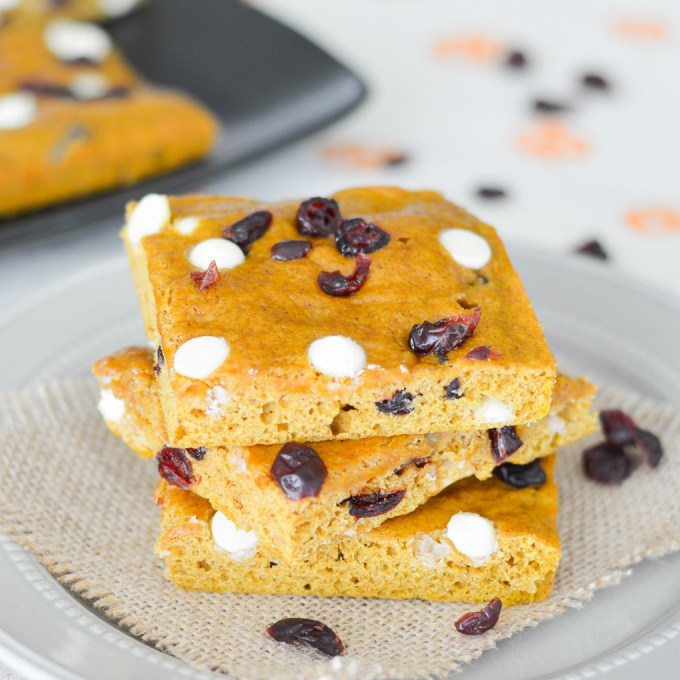 These Cranberry White Chocolate Pumpkin Bars are light, cakey and perfect for fall! If you like pumpkin spice everything, you'll love this delicious autumn dessert!