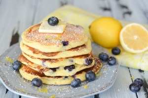 These Blueberry Lemon Ricotta Pancakes are super silky and creamy. They're packed with plump blueberries and brightened up with fresh lemon zest!