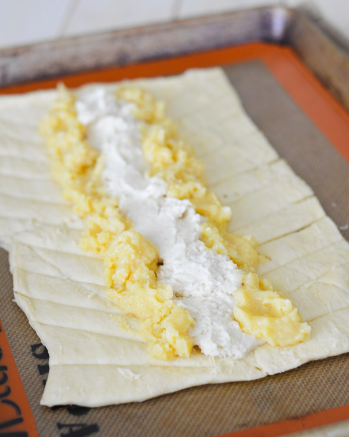 This Lemon Cream Cheese Danish Braid is easy but impressive, and perfect for your next brunch! Crescent roll dough stuffed with lemon curd and sweetened cream cheese bakes up perfectly and so prettily!