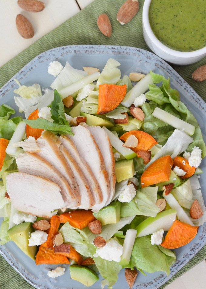 This Sweet Potato & Apple Salad is topped with a delicious homemade basil vinaigrette and packed with so much flavor. A bed of tender butter lettuce is topped with sweet potatoes, tart green apples, creamy feta, crunchy almonds and lots more!
