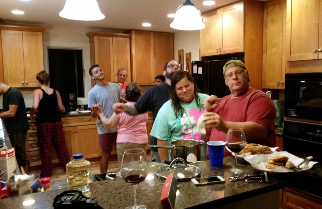 Family cooking empanadas on vacation in Asheville, NC