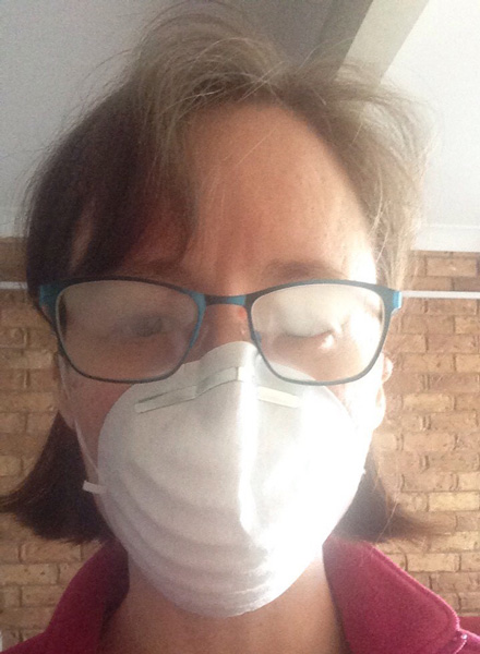 Me wearing a dust mask which is causing my glasses to fog up.