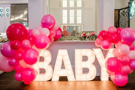 Cute Pink Baby Shower Ideas featured by top Houston lifestyle blogger and expecting mom, Jessica Crum. | Pink Baby Shower by popular Houston motherhood blogger, Jessica Crum: image of a Alpha Lit Austin baby marquis sign.