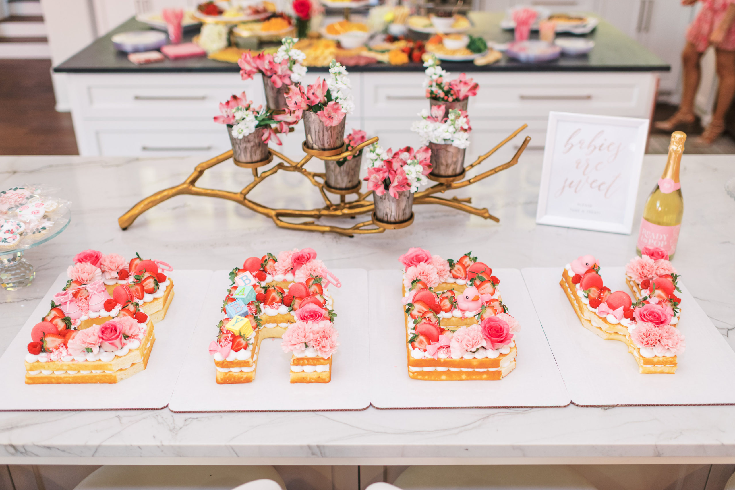 Cute Pink Baby Shower Ideas featured by top Houston lifestyle blogger and expecting mom, Jessica Crum.   Pink Baby Shower by popular Houston motherhood blogger, Jessica Crum: image of a pink baby shower cake by Busy Bees Bakery HTX.