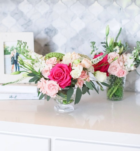 Cute Pink Baby Shower Ideas featured by top Houston lifestyle blogger and expecting mom, Jessica Crum.   Pink Baby Shower by popular Houston motherhood blogger, Jessica Crum: image of pink, white, and green floral arrangement by Picked Flower Co.