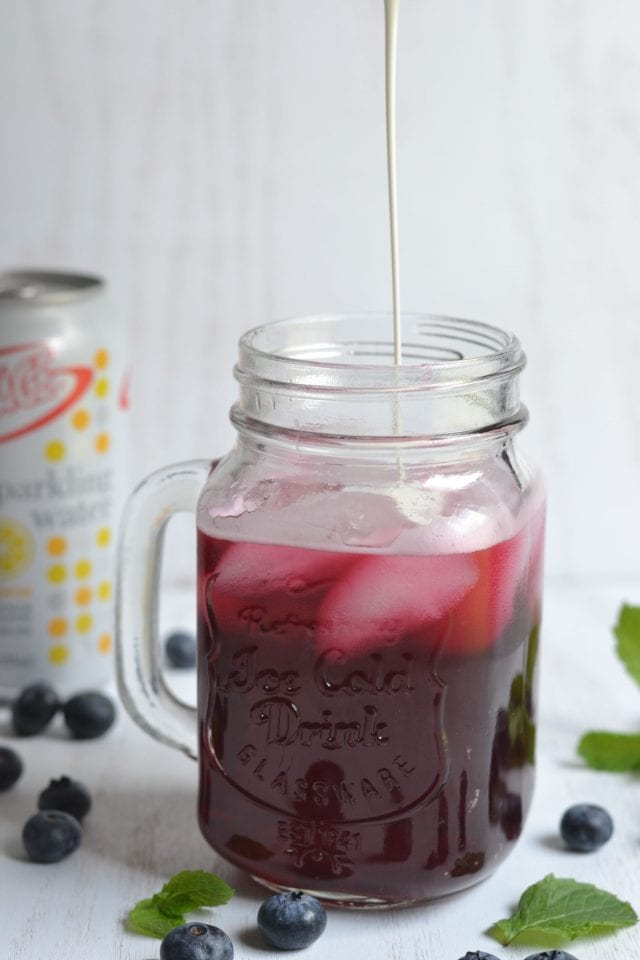 Blueberry Mint Italian Cream Soda. A tangy, bubbly, and refreshing drink bursting with blueberries and a hint of mint that's certain to tantalize your taste buds.