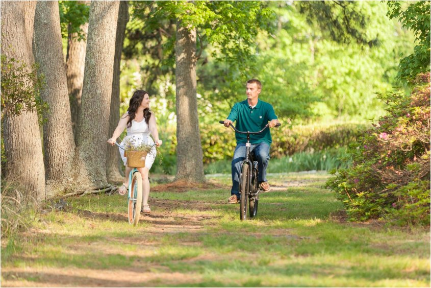 portsmouth engagement portraits couple riding bikes together