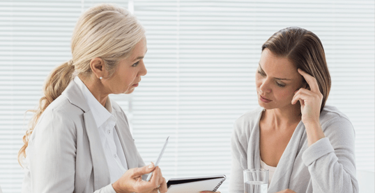 therapist helping client overcome domestic violence