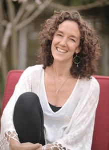 Jessie Rhines, seated outdoors