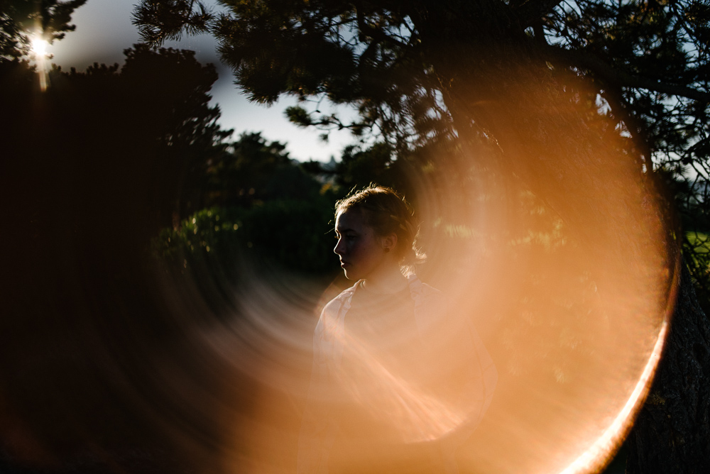 Senior portrait with sunflare in natural setting by Tacoma Senior Photographer Jessica Uhler Photography