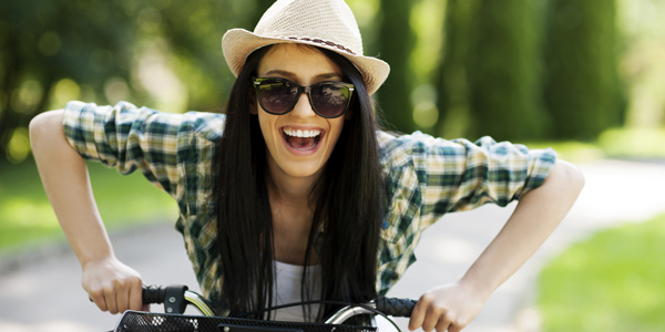 Happy young woman with bicycle; Shutterstock ID 126656333; PO: aol; Job: production; Client: drone