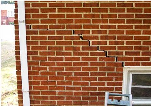 Stair-step brick cracks are another sign of foundation settlement