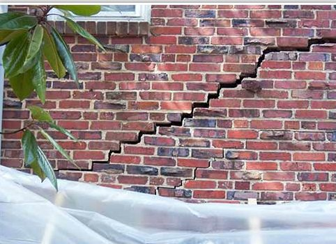 These brick cracks are no joke - this house required piers which have completely fixed the problem