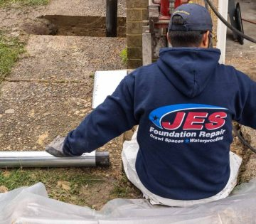 JES employee working at a home - Hometown Hero