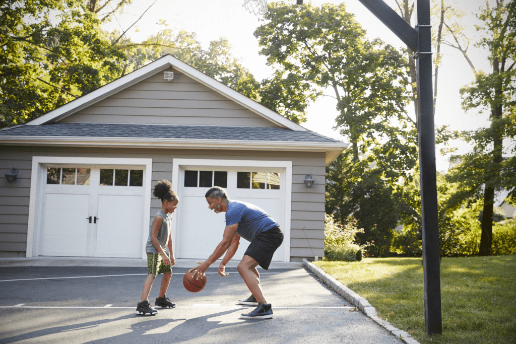 Playing basketball in driveway