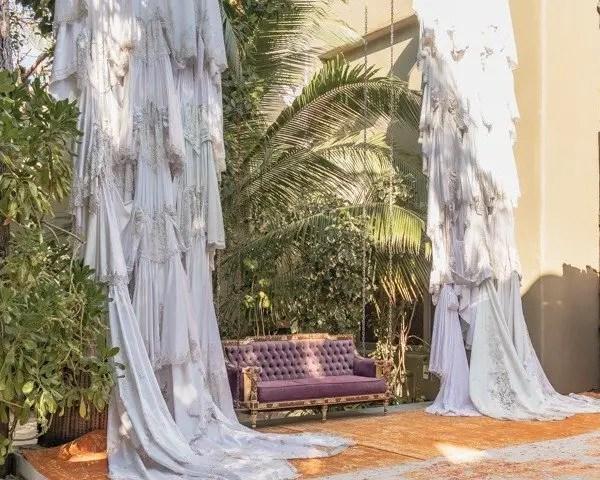 Extravagant sofa with hanging wedding dresses. Entrance into Casa Malca