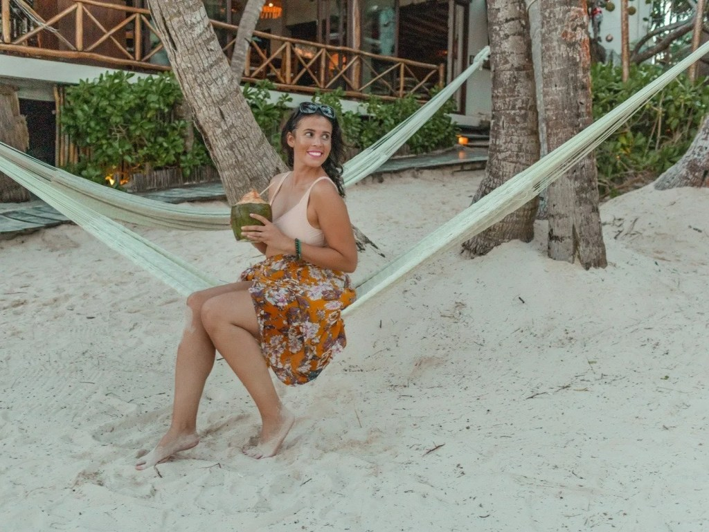 Me posing on a hammock with a coconut