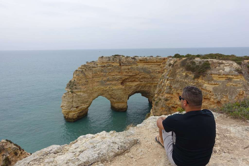 Man overlooking the Cliffs of Marinha