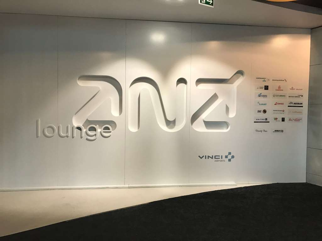 White sign with ANA lounge