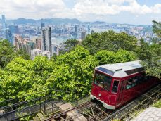 Red rail train overlooking Hong Kong