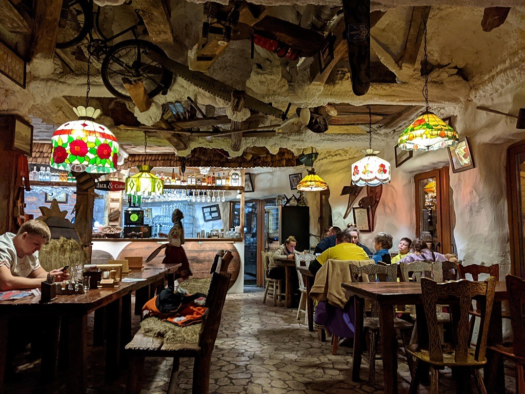 The interior of the restaurant is a mix of a Crazy grandma's house and a travertine cave