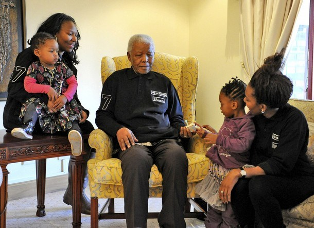 Former President Nelson Mandela prepares for his 93rd birthday with family members at his home in Qunu in this handout photo released by the Mandela family July 17, 2011. Mandela's birthday falls on July 18. With Mandela are (L-R) family members Zaziwe and Ziphokazi Manaway, Zamakhosi Obiri and Zamaswazi Dlamini. REUTERS/Peter Morey/Handout (SOUTH AFRICA - Tags: POLITICS PROFILE) ) PICTURE MAY ONLY BE USED UNTIL JULY 24, 2011. NO SALES. NO ARCHIVES. FOR EDITORIAL USE ONLY. NOT FOR SALE FOR MARKETING OR ADVERTISING CAMPAIGNS. THIS IMAGE HAS BEEN SUPPLIED BY A THIRD PARTY. IT IS DISTRIBUTED, EXACTLY AS RECEIVED BY REUTERS, AS A SERVICE TO CLIENTS. MANDATORY CREDIT