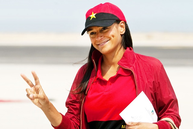 Image #: 21003915 epa03561008 A file photo dated 27 August 2012 shows Isabel dos Santos posing and making the V sign in Lobito, Angola, 29 January 2013. Isabel dos Santos, the oldest daughter of the Angolian President, is a business woman and investor, and, according to Forbes Magazine's recent calculations, she is Africa's first female billionaire. On top of her interests in oil and diamonds, she has significant shares in telecommunications, media, retail, finance and the energy industry, both in Angola and in Portugal. EPA/PAULO NOVAIS /LANDOV