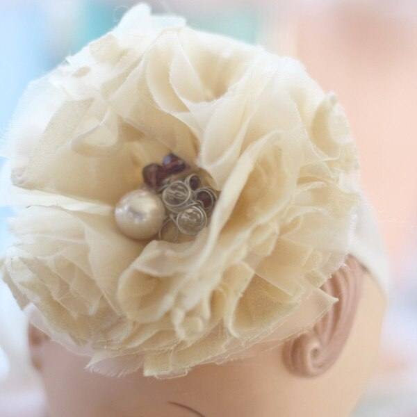 Learn to make this rustic fabric flower with the Carnation Fabric Flower Tutorial