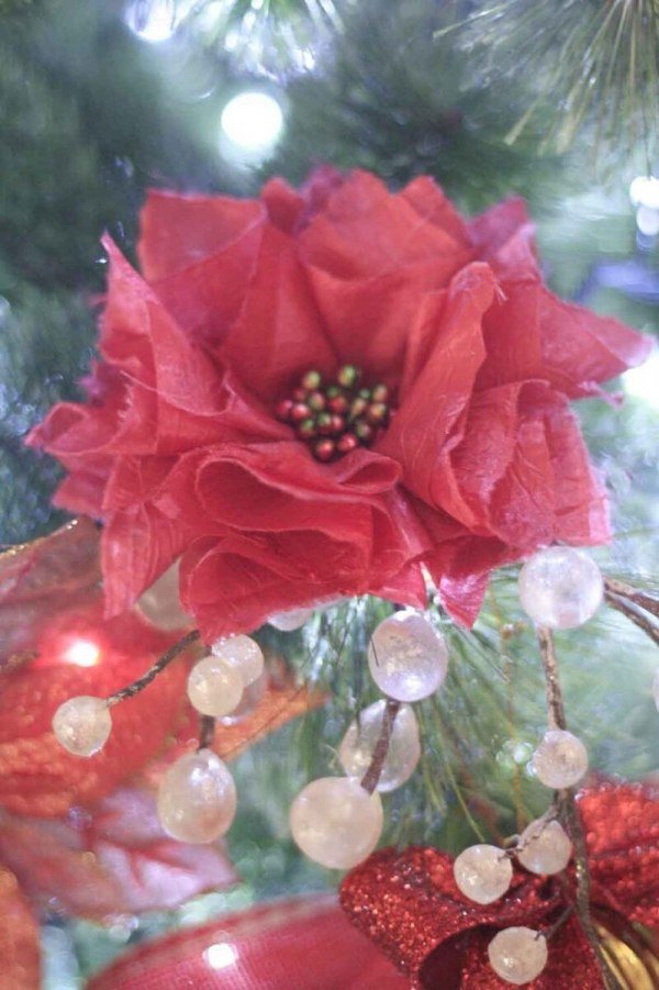 A Red Poinsettia Handmade Fabric Flower Christmas Tree Ornament made with the Carnation Tutorial