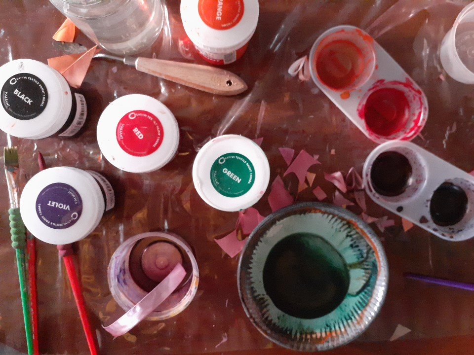 paint is all over the place on a craft table