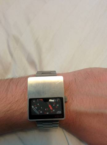 13 - This watch is heavier than it looks it uses four hands and a semi-circle design to tell time