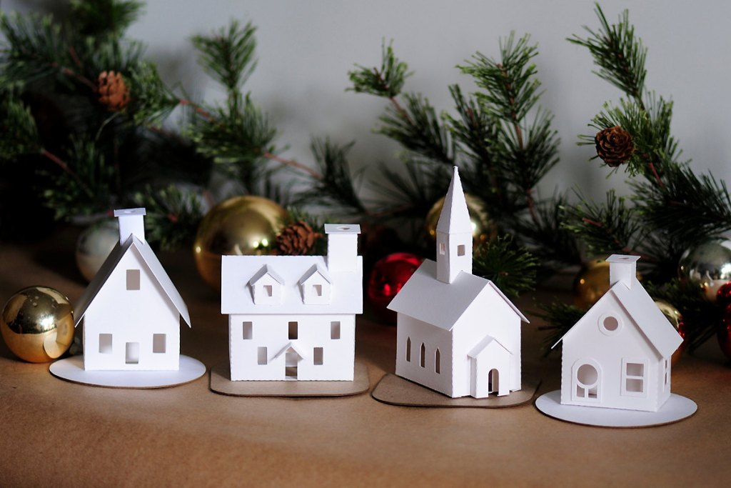 A four piece village ornament kit from Holiday Spirits Decor.