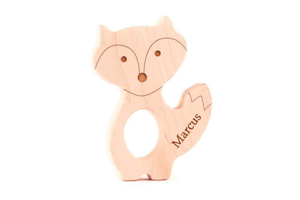 The front of a personalized wooden fox teether from Smiling Tree Toys.