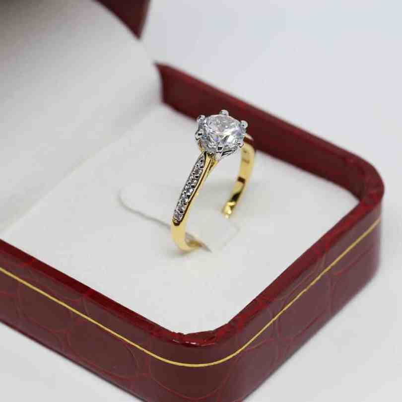 Round cut engagement ring in a red box
