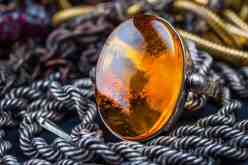 Baltic Sea amber stone ring with silver band