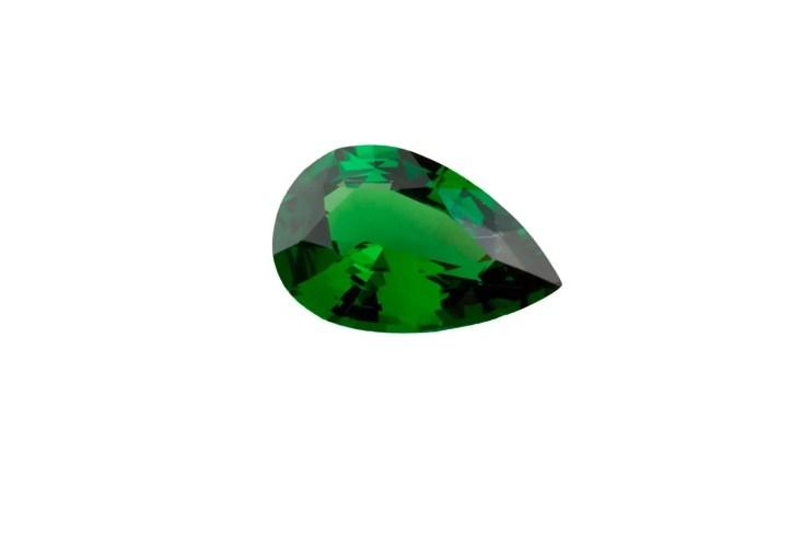 an isolated green tsavorite garnet gem stone