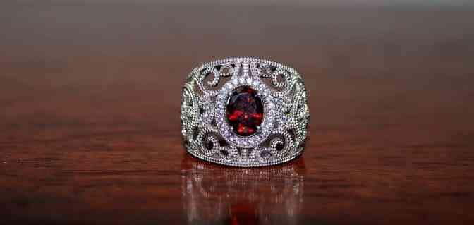 Red garnet ring with diamond close up