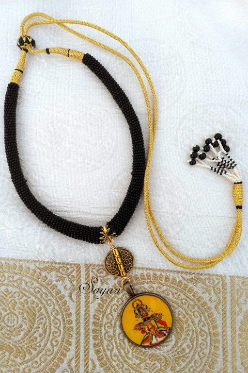 Therukoothu glitter pendant