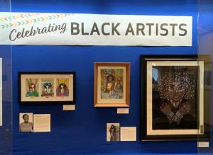 Window showcase displaying the art of Black Artists.