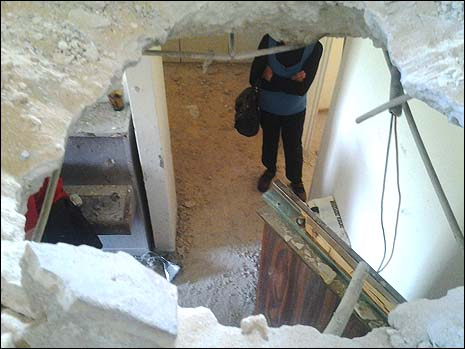 A Gaza rocket left a gaping hole in the floor and ceiling of the Leibovitzs' Ashkelon apartments.